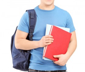 Student carrying a bag smiling Stock Photo