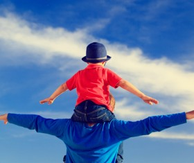 The child sitting on the fathers shoulder Stock Photo 02