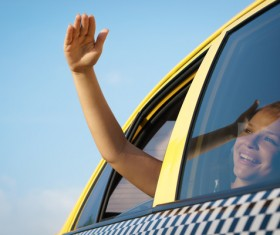 The girl who looks at the sun in Taxi Stock Photo 01