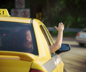 The girl who looks at the sun in Taxi Stock Photo 02