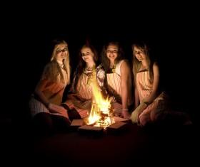 The girls around the campfire Stock Photo