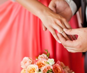 The groom wore a wedding ring for the bride Stock Photo