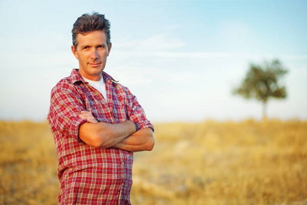 The man standing in the wheat field Stock Photo