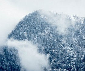 Thick fog on mountain landscape Stock Photo