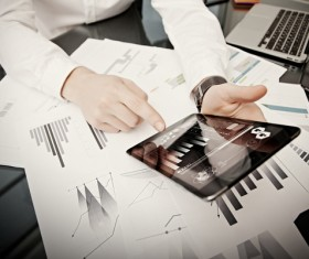 Use tablet to do business data analysis Stock Photo 01