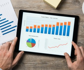 Use tablet to do business data analysis Stock Photo 06