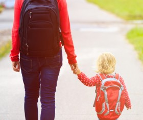 Walking mother and daughter Stock Photo