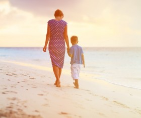 Walking on the beach mother and child Stock Photo