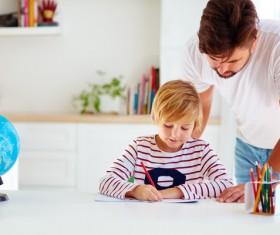 Watching children write homework father Stock Photo
