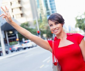 Waving to hit Taxi girl Stock Photo
