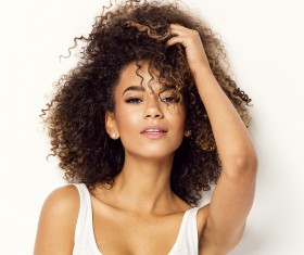 Wear cool clothing fluffy short curly hair young woman Stock Photo 07