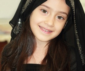 Wearing black veil beautiful little girl Stock Photo