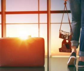 Woman holding camera and travel bag Stock Photo