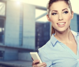 Woman holding cellphone Stock Photo