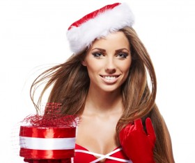 Woman in Christmas dress holding gifts Stock Photo