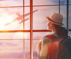 Woman looking at air plane Stock Photo