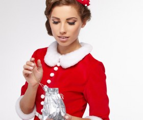 Woman opening Christmas gift Stock Photo