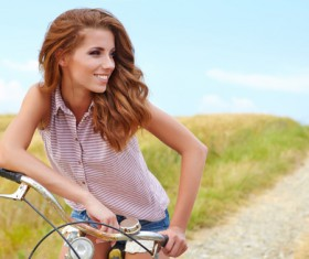 Woman riding a bicycle on the outskirts Stock Photo 01
