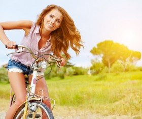 Woman riding a bicycle on the outskirts Stock Photo 02