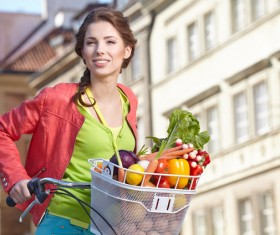 Woman riding a bike to buy food Stock Photo