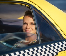 Woman sitting in a taxi car Stock Photo