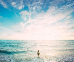 Woman standing in the waves Stock Photo