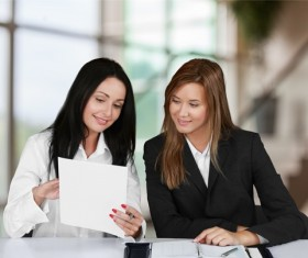 Women learning from each other Stock Photo