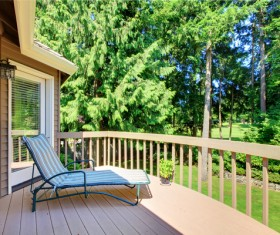 Wooden balcony with lounge chairs Stock Photo