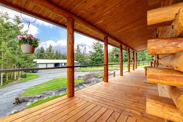 wooden house with flower basket under the eaves stock. Black Bedroom Furniture Sets. Home Design Ideas