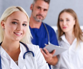 Young female doctor posing with colleague Stock Photo