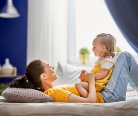 Young mother and kids play games Stock Photo