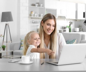 Young mother with daughter at home Stock Photo 01