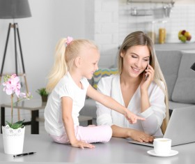 Young mother with daughter at home Stock Photo 03