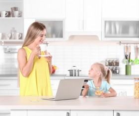 Young mother with daughter at home Stock Photo 06
