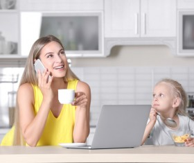 Young mother with daughter at home Stock Photo 07