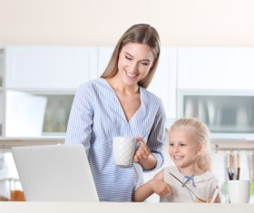 Young mother with daughter at home Stock Photo 10