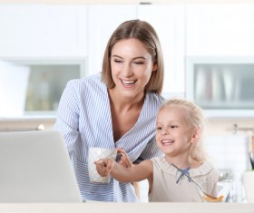 Young mother with daughter at home Stock Photo 11