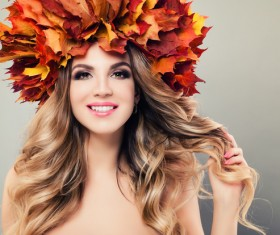 girl wearing red maple leaf wreath Stock Photo 02