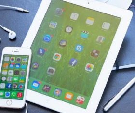 iPhone and Tablet Social Media Applications Stock Photo