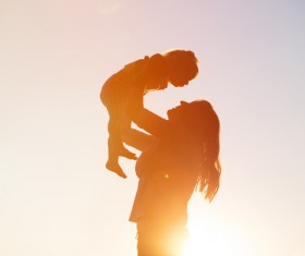 lift the mother of the child Stock Photo