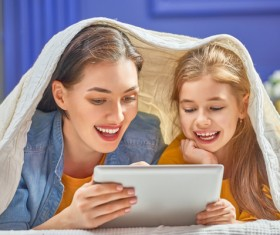 mother and her daughter girl are playing with tablet Stock Photo 03