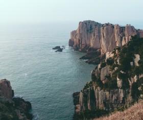 tranquil rocky beach landscape Stock Photo