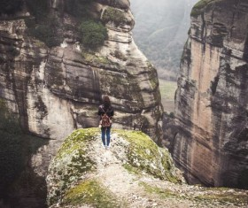 woman standing on the edge of cliff Stock Photo