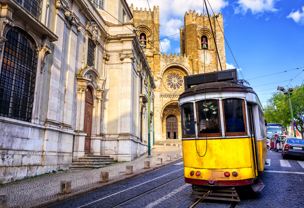 Ancient church and city tram Stock Photo
