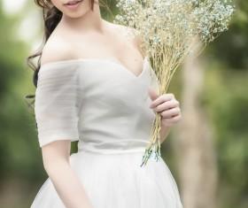 Asia girl hold wildflowers Stock Photo 01