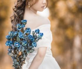Asia girl hold wildflowers Stock Photo 02