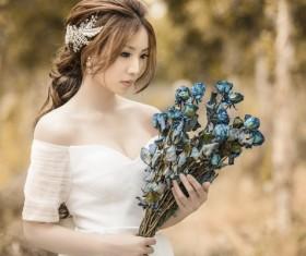 Asia girl hold wildflowers Stock Photo 03