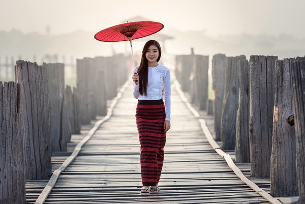 Beautiful Southeast Asia girl with red umbrella Stock Photo