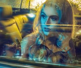 Beautiful blonde sitting in limousine Stock Photo