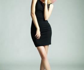 Beautiful girl in black short dress Stock Photo
